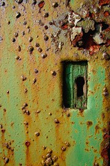 Through the key hole. (Ian McWilliams.) Tags: door wood green metal rust lock keyhole platinumphoto canon350defs1855mm