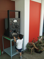Owen climbing on old physics equipment