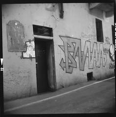a wall (mathias shoots analogue) Tags: blackandwhite italy milan 120 6x6 analog lomo milano ilfordhp5 analogue nophotoshop lubitel166u navigli sovietcamera disagiosociale