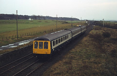Class 116 d.m.u. northbound on Troon avoiding line, Lochgreen Jn. 07-11-82. A.Wilson