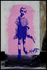 Child with Toy Hand Grenade in Hackney (Herschell Hershey) Tags: park street london art toy graffiti stencil gun child hand with central shoreditch hoxton hackney grenade twat londonist dianearbus colinwood