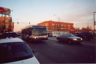 Southbound CTA Route # 54 Cicero Avenue bus at the intersection of west Belmont and North Cicero Avenues. Chicago Illinois. December 2003.
