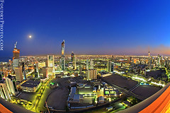 Kuwait City at night (A.alFoudry) Tags: city blue roof sunset red sky orange sun moon reflection building set night canon buildings photography eos photo high shot nightshot dusk top dar full fisheye frame 5d kuwait fullframe 2008 15mm f28 ef kuwaitcity kuwaiti q8 abdullah  canoneos5d  kuw alawadhi q80 q8city canonef15mmf28fisheye xnuzha alfoudry  abdullahalfoudry foudryphotocom  daralawadhi