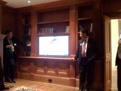 Ethan Berkowitz watching video of Sarah Palin taken during their Alaskan gubernatorial debate