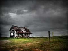 In Spite Of... (evanleavitt) Tags: county morning roof house storm texture abandoned clouds rural ga georgia tin darkness decay country olympus madison rainy hdr e510 photomatix