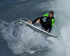 Green Hurley (ScottS101) Tags: man male green beach youth surf waves action surfer air huntington wave surfing aerial surfboard athlete olas hb hurley wetsuit