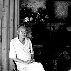 The godfather of blacksmiths (... Arjun) Tags: portrait blackandwhite bw 15fav texture monochrome 1025fav 510fav square sketch nikon asia picture 100v10f shades vietnam study photograph squareformat d200 blacksmith redriver hanoi 2008 tones godfather description representation indochina portrayal likeness oldquarter depiction 34mm thanglong 18200mmf3556g visualrendering bluelist songhong cityofthesoaringdragon citeindigene pholoren