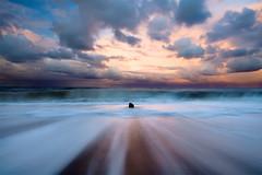 Moving In Familiar Water (jasontheaker) Tags: uk longexposure sunset england storm beach rain movement energy waves yorkshire accepted1of100 north whitby emotive sandsend landscapephotography jasontheaker pprowinner