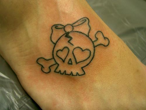 tatuagem caveira feminina