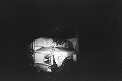 Bus (ctpreda) Tags: blackandwhite abstract night orlando lomo lomography lowlight florida flash wideangle 35mmfilm grainy shotfromthehip fromthehip ringlight lomofisheye 170degrees