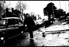 Rain dog (Fritenks) Tags: ireland bw dog alone taxi belfast northernireland stolen irlanda tomwaits blackcab ulster raindogs fallsrd streetsinbelfast