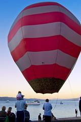 Balloons at Sunset (-Nicole-) Tags: sunset newzealand d50 balloons nikon nikond50 wellington hotairballoons orientalbay orientalparade wellingtonnewzealand wellingtonnz file:name=200803239187