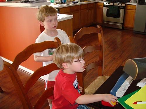 Josh teaching Sam to use the computer