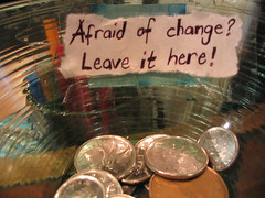 'Afraid of change? Leave it here!' note on a tip jar in Vancouver