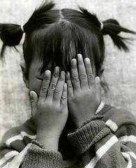 ... a pretence of shyness ... (richard thomson) Tags: blackandwhite bw topf25 hands nikon shy vietnam 35mmfilm hanoi fp4 nikonfe2 fe2 85mmf2 scanofaprint