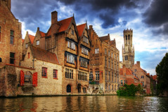 Bruges (Wolfgang Staudt) Tags: morning travel blue lake reflection water clouds river early canal nikon europe belgium awesome urlaub tripod earlymorning tourist worldheritagesite belfry bruges reflexions spiegelung hdr brujas belfort weltkulturerbe belgien d300 flandern brgge beffroi reisefotografie wolfgangstaudt  66111 flemishregion excellentphotographerawards theunforgettablepictures nikond300  belfryofbruges nikonflickraward  belfortvanbrugge beffroidebruges   brj  grouptripod weltkulturerbebrgge