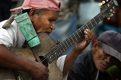 musikero (AlmaZosan) Tags: man blind guitar alma philippines player oriental negros sibulan musikero alcoran zosan