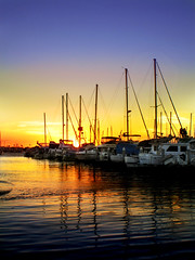 Harbor (cagurl23) Tags: ocean california sunset sky sun reflection beach water clouds sailboat boats boat pacific bright yacht pacificocean longbeach sail sailor boatyard waterreflection brightsky longbeachharbor longbeachcalifornia mywinners