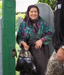 A woman receiving food and water with thanks