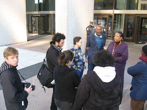 PANW editor, Abayomi Azikiwe, speaks with Sen. Carl Levin's aide and members of the Moratorium Now! Coalition to Stop Foreclosures and Evictions outside the McNamara Federal Bldg. in downtown Detroit on Oct. 3, 2008. (Photo: Alan Pollock). by Pan-African News Wire File Photos
