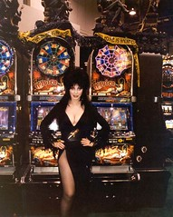 Elvira standing in front of her slot machines in 2002