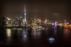 Shanghai - The New World Capital (Photomike07 / MDSimages.com) Tags: world china city travel november urban reflection water architecture night clouds digital port photography boat blog media asia neon glow cityscape skyscrapers shanghai nightshot expo capital east capitol needle citylights processing hyatt metropolis lit prc  orient 2008 fareast bund hdr cyberpunk cityskyline sleepless anthonybourdain noreservations shnghi travelphotographer znhae hyattonthebund michaelsteighner mdsimages hyliteproductions photomike07 peoplesrepublic mdsimagescom hylitecom worldsfair