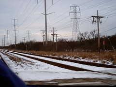 Driving over tracks (Madame Maracas) Tags: winter snow vanishingpoint powerlines zippy telephonepoles greysky rl reallife railroadtracks persepective
