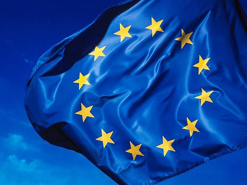 the european flag flying, blue field with a circle of gold stars
