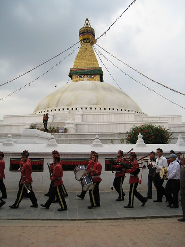 A wedding procession circles the stupa