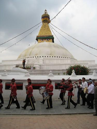 A wedding procession circles the stupa