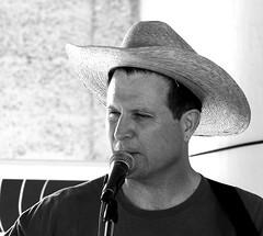 DSC_7472 (sara97) Tags: bw music usa guitar missouri microphone saintlouis cowboyhat strawhat towergrovepark yodeling ropetricks towergrovefarmersmarket familyconcert harvestsessions kdhxcommunitymedia thewhitakerfoundation photobysaraannefinke westpoolpavilion copyright2008saraannefinke cowboyrandyerwin cowboyrandy