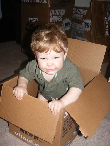 Alex playing with a box while we pack