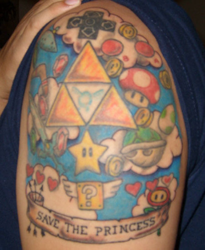 Newest photo →; Legend of Zelda / Super Mario tattoo
