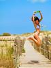 Enjoy summer (and beer) (Sator Arepo) Tags: summer vacation holiday beach fun happy reflex bottle jump jumping action joy happiness delta olympus highkey ebro zuiko feelin riumar e500 uro deltadelebro 50mmmacroed fmuro37 gettyholidays2010 yehey~