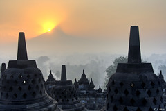 Sunrise at Borobudur (J.^2) Tags: morning mist mountain fog sunrise canon indonesia temple volcano bell stupa buddhist smoke yogyakarta j2 hdr borobudur jiangjiang centraljava 3xp mountmerapi 400d jsquare