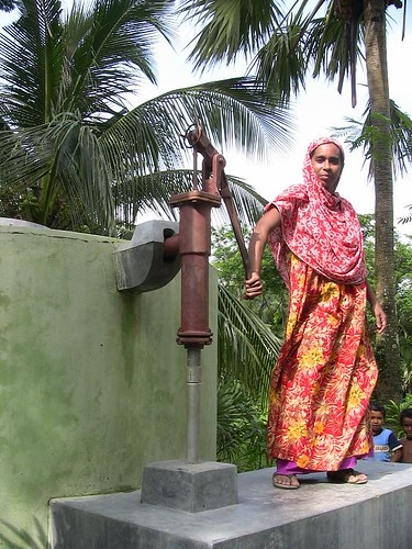 Local Villager Pumps Water into the Pond Sand Filter (Save the Children USA)
