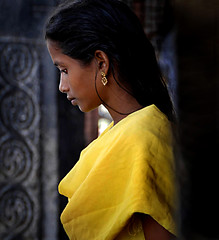 Contemplation (Rick Elkins) Tags: woman india yellow temple bravo candid profile tamilnadu theface tanjore themoulinrouge artisticexpression fpg mywinners abigfave artlibre brihadiswaratemple anawesomeshot superaplus aplusphoto infinestyle portraitaward betterthangood multimegashot rickelkins
