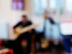 Blurry image of a bassist