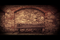 Horizontals: Bench (manganite) Tags: red brick colors yellow stone wall sepia digital germany dark bench geotagged bayern bavaria nikon europe mood tl framed empty atmosphere d200 nikkor dslr toned vignette irsee 18200mmf3556 utatafeature manganite nikonstunninggallery repost1 date:year=2008 date:month=september date:day=17 klosterirsee geo:lat=4791069 geo:lon=10575365 format:orientation=landscape format:ratio=21