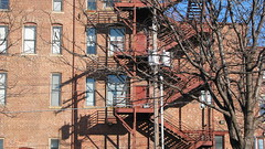 SOMETIMES THERE IS SIMPLY NO ESCAPE FROM CRAP... (roberthuffstutter) Tags: iron poetry escape steps designs fireescapes worldzbestfotoz huffstutter heatdeflectors napkinpoetry