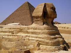 Sphinx  of Giza / Lower Egypt () Tags: africa man art cemetery grave graveyard sphinx architecture design sand ancient ruins flickr king desert pyramid northafrica profile lion egypt graves pharaoh goldenage publicart egipto ramadan rtw giza gypten egitto egypte wste pirmides roundtheworld gizeh ancientegypt afrique khufu cheops dsert  chephren antiquities globetrotter greathouse northernafrica    worldtraveler gizanecropolis nemes aljizah loweregypt  greatsphinx greatsphinxofgiza 4thdynasty  khufuspyramid nemesheaddress  bodyofalion  ivdynasty dreamstella  suphis 4 nemesheadcloth desertumafricanum