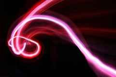 LED Magic (Audiotribe) Tags: longexposure pink blue light abstract color colors digital canon lampe licht exposure glow colours snake lumire ghost trails experiment led tokina trail frisbee swirls trippy lys eyecandy bikelight cahaya svjetlo ligero ljus 2035mm ledlight  slange cykellygte sooc eos400d electricoctopus colorphotoaward colourartaward  ledlicht exposureeffect  lysspor
