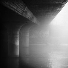 under (koinis) Tags: bridge bw white mist black water fog john 50mm stream explore getty 18 sv nykping svartvit sqr 500x500 koinberg koinis winner500