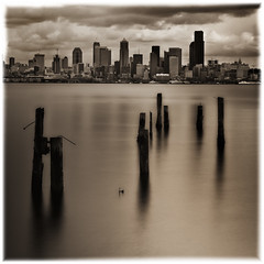Downtown Seattle from where I stand! (mcazadi) Tags: seattle longexposure sky bw clouds downtown photos award pilings soe firstquality dancing fineartphotos diamondclassphotographer flickrdiamond ysplix goldstaraward