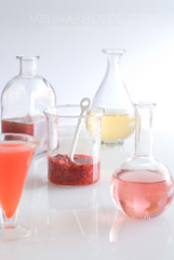 alchemy (mwhammer) Tags: pink red summer orange abstract color glass yellow design bright wine bottles display juice vibrant beverage drinking shapes experiment science clean cocktail liquor laboratory simple puree alchemy muddled propstyling foodstyling melinahammer