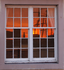 Through the square window (Alan Cleaver) Tags: windows sunset orange reflection home window port evening seaside ship harbour frame safe tallship masts tallships