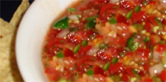 Homemade tomato salsa with citrus and jalapenos