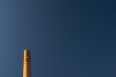 morning (xgray) Tags: street morning blue light shadow summer chimney sky sun brick tower contrast digital canon austin eos university texas bricks stack universityoftexas smokestack powerplant 24th circularpolarizer polarizingfilter efs1022mmf3545usm 40d postedtophotographersonlj