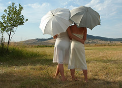 Umbrella sisters (MaureenShaughnessy) Tags: summer portrait seasons meadow pasture umbrellas slips bigskymontana