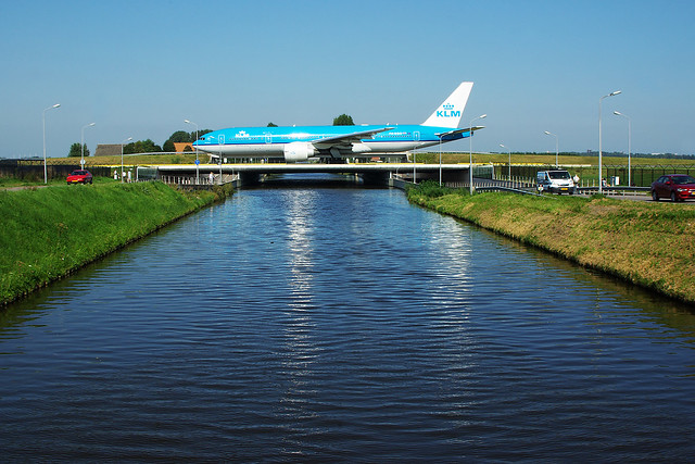 Airplane over road cars Schiphol KLM